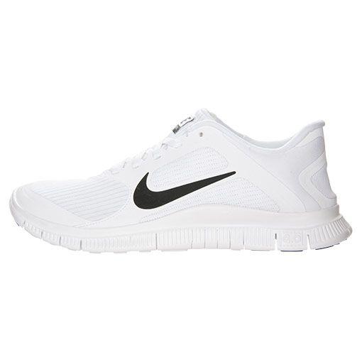 All white Nike 4.0 V3 running shoes. Slick.