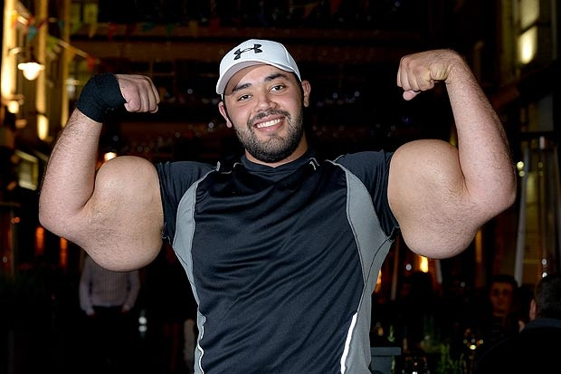 Moustafa 'Popeye' Ismail shows off the world's biggest biceps