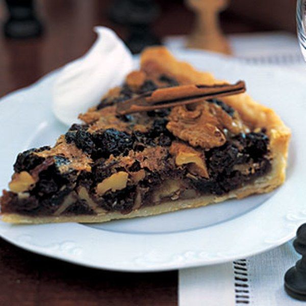 """This style of tart, which has a texture reminiscent of pecan pie but is spiced with cinnamon and lemon peel and studded with raisins, is a specialty of the Borders, a southeast region that stretches from the English border to just south of Edinburgh. Many variations exist, some of them simply called """"Border Tart."""" This one has as its namesake the village of Ecclefechan. Serve the tart at room temperature for afternoon tea or barely warm with a dollop of whipped cream and a scattering of…"""