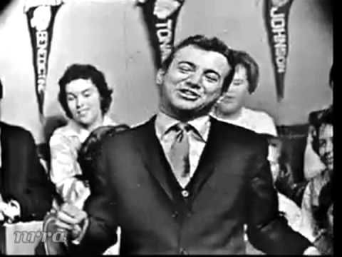 "Day 9 - a song you like in a genre apart from your usual ...... But I like so many different genres!!!  This one always takes me to a happy place in my mind.   Bobby Darin ""Beyond the Sea"" - YouTube"