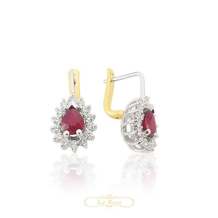 Cerceii LRY265 sunt sofisticati si rafinati. Cu rubin si diamante de 0.40 carate, din aur alb si galben de 18K se potrivesc celor mai elegante tinute.  http://www.bijuteriilarosa.ro/bijuterii-cu-diamant/cercei/cercei-lry265