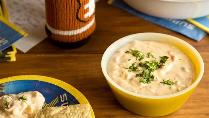 Whether you're tailgating, homegating or just craving cheesy goodness, this slow-cooker queso and Buffalo chicken dip are sure to score.