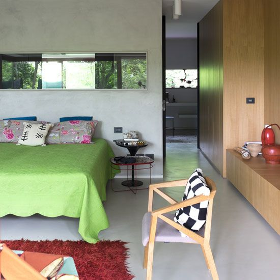 Bedroom Ideas: Small Bedroom with Green Bedlinen also Wooden Cupboard plus Simple Wood Chair and Red Feather Rug