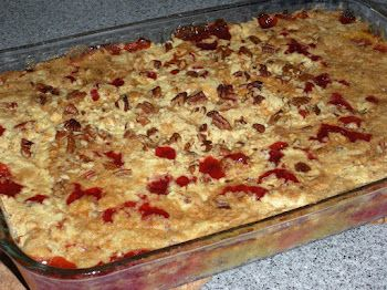Cherry-Pineapple Dump Cake: Grease a 9 x 13 inch pan. Dump in the pineapple and juice, spreading evenly. Pour cherry pie filling over the pineapple, spreading evenly. Add dry cake mix evenly over the fruit. Add nuts, then slice butter and lay all over the top. Do not mix. Bake in a 350 degree oven 1 hour.