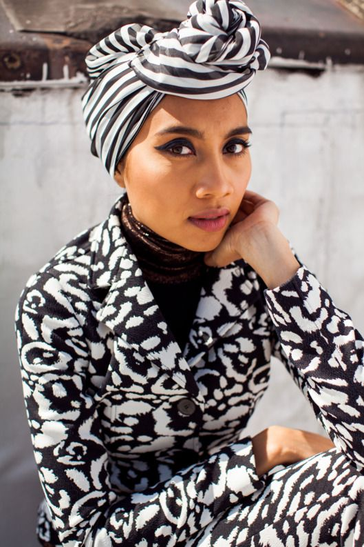 """Yuna on Fashion, Race, and Not Showing Her Hair -- Singer-songwriter Yuna is not your average pop star. A devout Malaysia-born Muslim with impeccable personal style and a sound like Sade, she's reimagining what it means to be a music and fashion icon. Her new album Chapters — which includes her hit single, """"Crush,"""" featuring Usher — was made with a host of Hollywood superproducers and has been met with critical acclaim."""