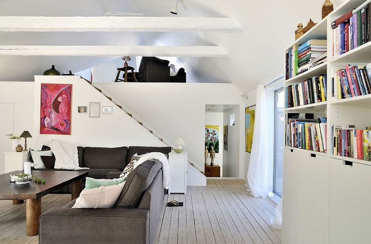 Fint med helvitt inomhus när det är litet.  Alluring-L-Shaped-Sectional-Sofa-with-Decorative-Pillows-and-Throw-Combined-with-Wooden-Rectangular-Coffee-Table-and-Bookcase-behind.jpg