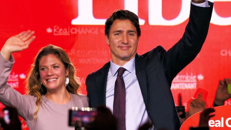 Justin Trudeau and Sophie Gregoire-Trudeau wave to supporters following his victory speech on Election Day, Monday, Oct. 19, 2015.