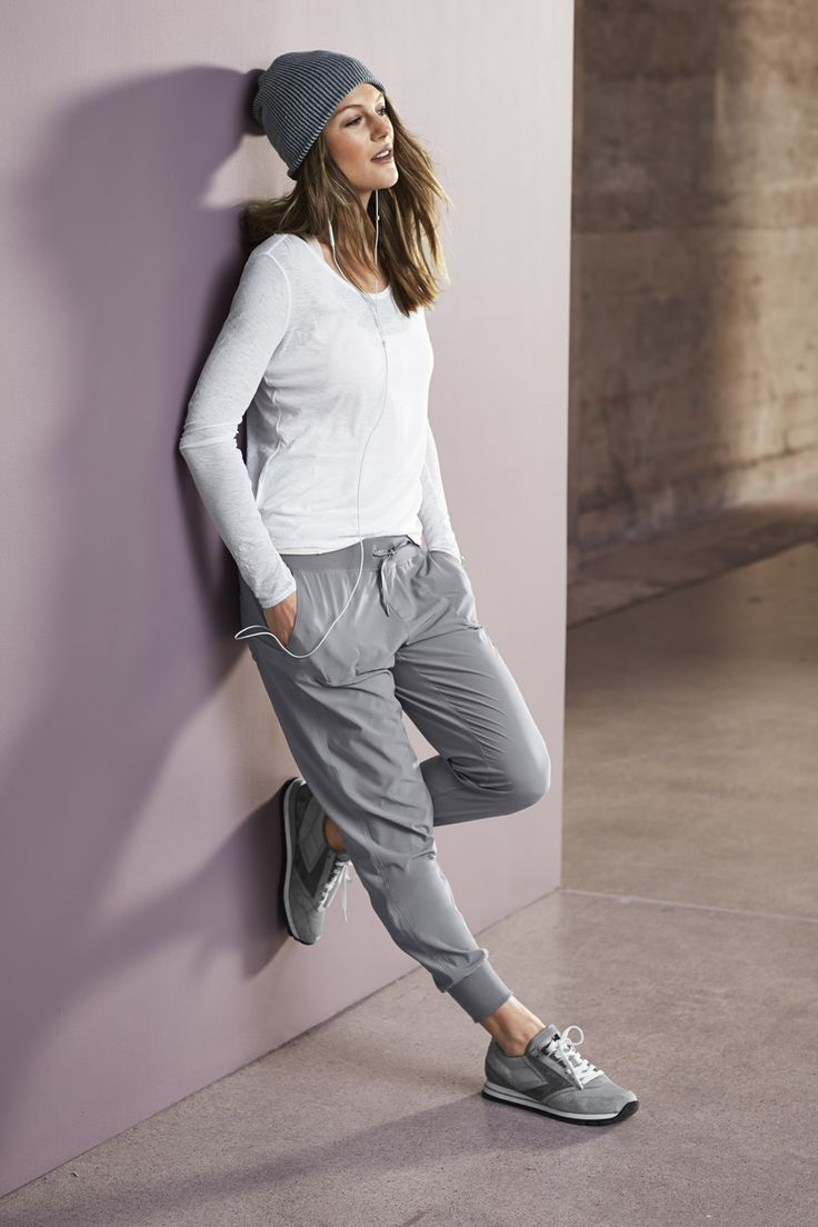 Shop this look on Lookastic:  http://lookastic.com/women/looks/charcoal-beanie-white-long-sleeve-t-shirt-grey-sweatpants-grey-athletic-shoes/8011  — Charcoal Beanie  — White Long Sleeve T-shirt  — Grey Sweatpants  — Grey Athletic Shoes