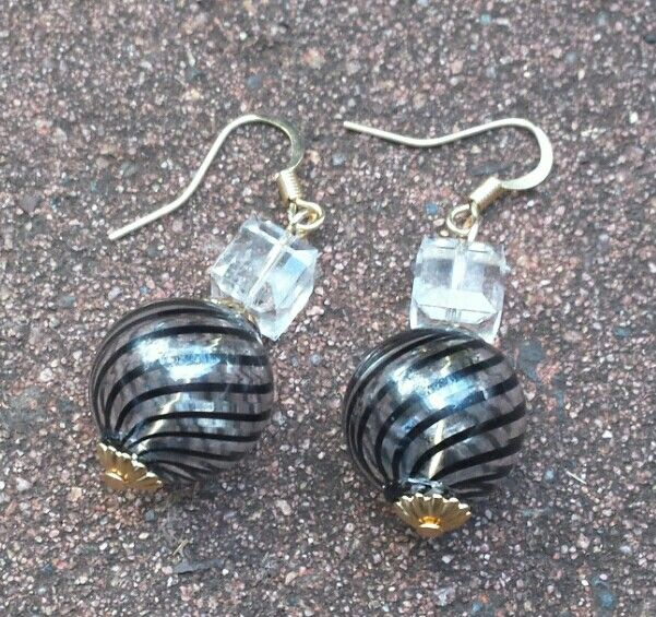 Mouth blown Murano glass bead earrings with Swarovski Crystal cube beads as accents I created.