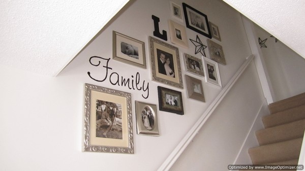 Stairway picture gallery. Really like everything about this. Monochromatic, carried same frame throughout to draw the eye and the use of the letters & star.