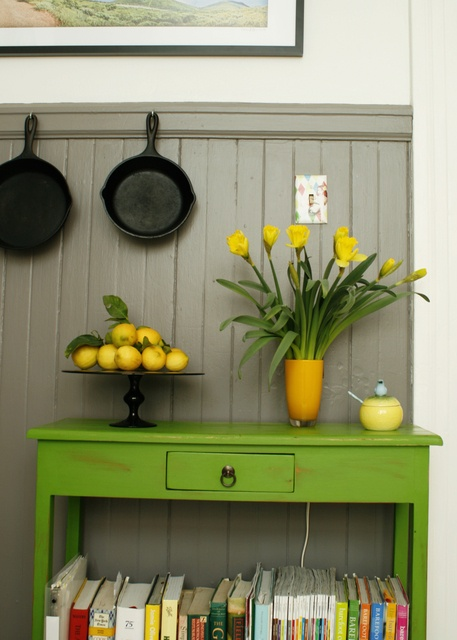 These two colors play off each other brilliantly!  Also the idea for hanging the cast iron pans is sound...although i do wonder what kind of industrial strength hook must be drilled into that wall.