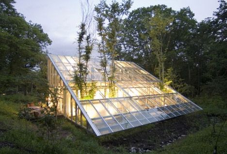 This beautiful small, inexpensive and modern home design is anything but what it seems. From a distance this curiously simple-looking green house almost disappears into the natural landscape and up close it looks like a broken old greenhouse with trees slowly pushing up through its remains.