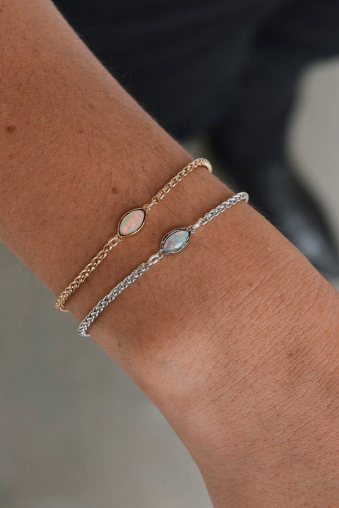 """STYLE   Delicate snake chain bracelet with opal embellishment STONE   Welo Ethiopian OpalSIZING   6"""", 7"""" and 8"""" with 1"""" adjuster MATERIAL 14kt gold overl"""