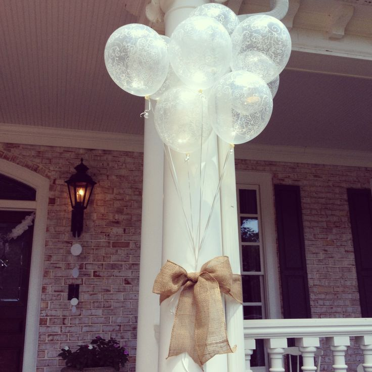 Cute bridal shower outdoor decor! Simple and beautiful! Burlap, ribbon an balloons.