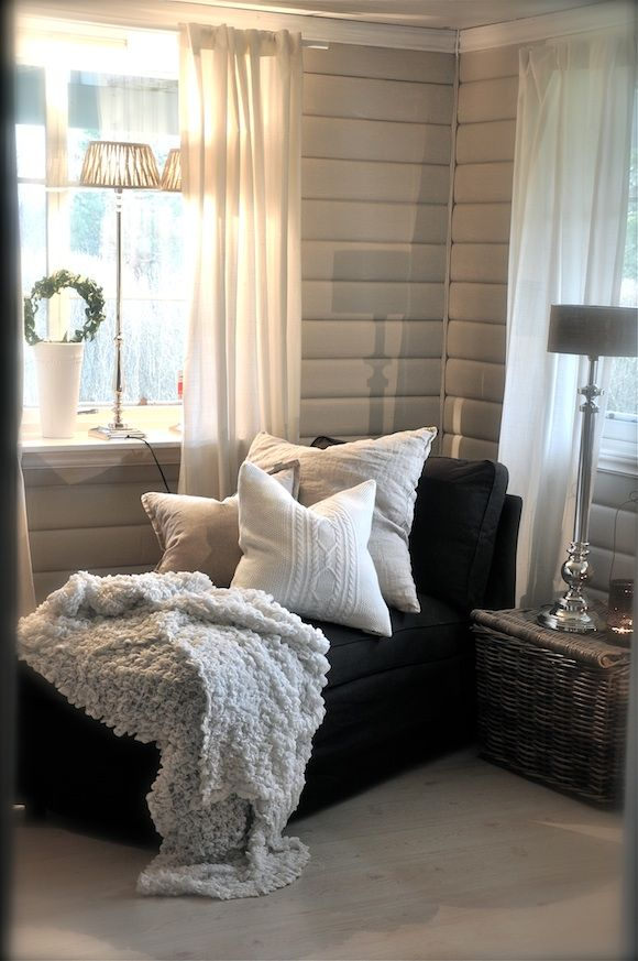master bed - chair/chaise in corner with vintage pillows and throw