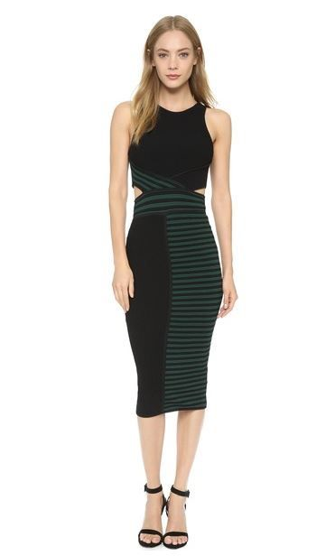 RONNY KOBO Megan Dress Cutaway detailing accents the cropped bodice on this two-tone, ribbed knit Ronny Kobo dress. Exposed zips close the back and vent the skirt. Sleeveless. Unlined