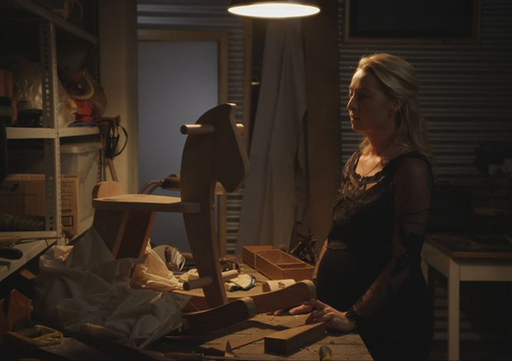Nina finds the rocking horse Patrick has been working on for their child