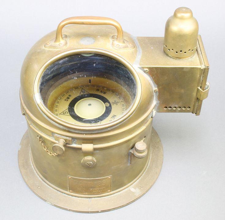 Lot 819, A brass ships binnacle marked Patt183 containing a gimbal compass no.71949BHS/24724, est £50-75