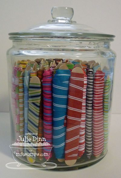 Wind your ribbon around tongue depressors and fasten w/ a pin. Store in big jars. Smart!