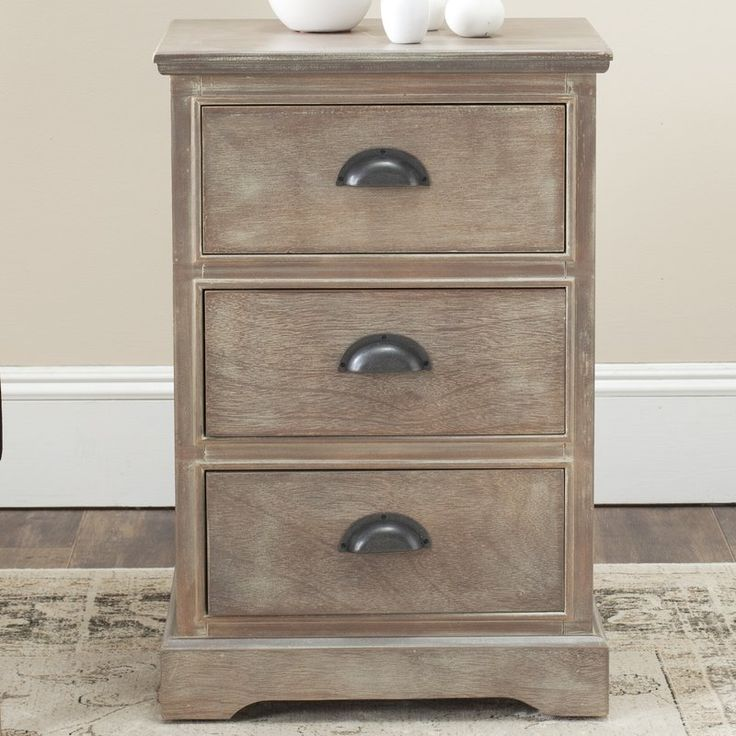 Addie 3 Drawer Bedside Table Grey Wash. A versatile foundation for your beautiful bedside vignette, this timeless Addie 3 Drawer Bedside Table is perfectly topped with a vase of freshly-picked blooms or a pair of glowing candle lanterns.