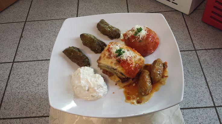 Mixed Greek Plate (Stuffed Vine Leaves, Stuffed Tomatoes,Moussaka,Tzatziki and Meat Balls )