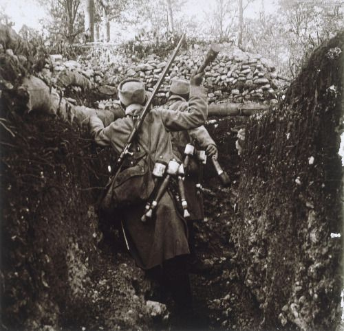 WWI; French soldiers using handcrafted grenades in the Wöevre trench (Meuse). The design of these grenades was probably inspired by the German ones.