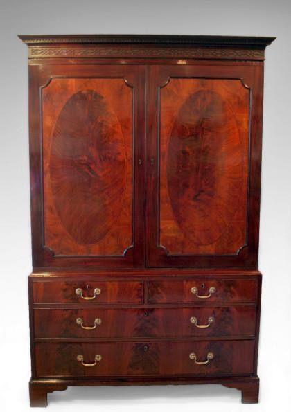 18th century Georgian linen press. Veneered in flame curl veneers to draw fronts and door panels. Inside 4 trays.