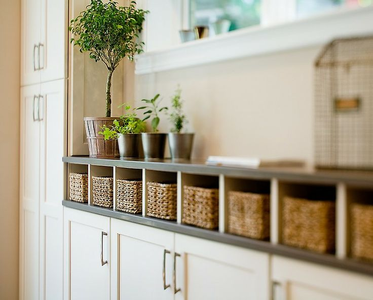 Absolutely stunning cubby holes filled with woven baskets. Great idea!