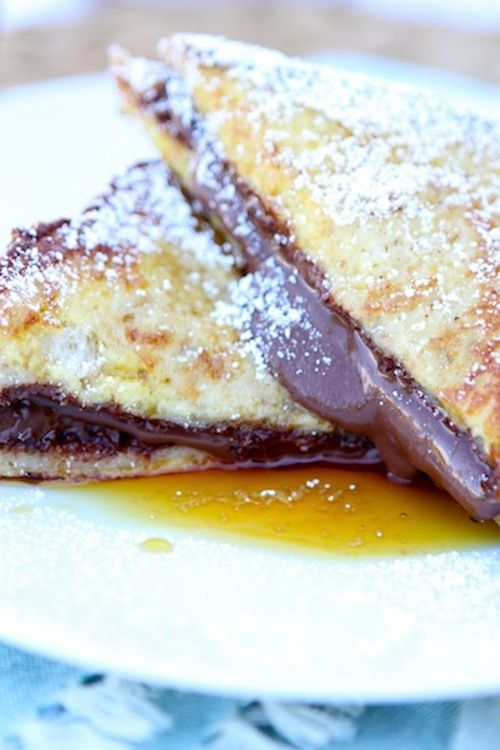 Nutella Stuffed French Toast Recipe on twopeasandtheirpod.com This French toast is decadent and divine!