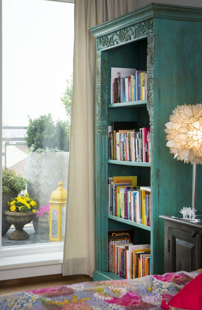 Turquoise wooden library combined with Mother of pearl standing light.