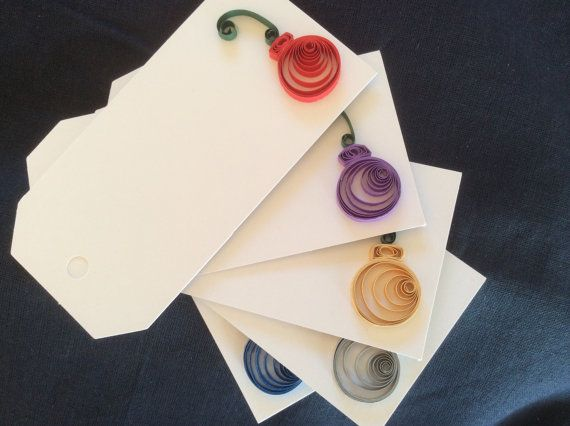 This set of 5 quilled Christmas Ornament gift tags will make a unique addition to any holiday gift. The ornaments come in red, purple, silver, gold and blue but you can select your own colors if you choose.