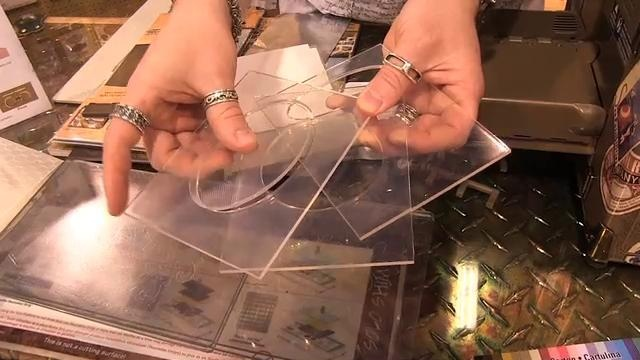 Tim Holtz shows how to use his Embossing Diffusers