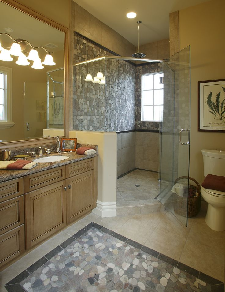 Pics On Master bathroom with a huge corner shower along with a rainfall shower head They also added a marble countertop custom cabinetry and a botanical print