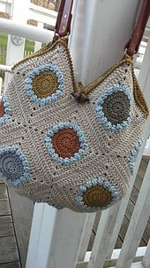 "This tote is made up of 13 identically sized squares. Each square has a round center section, bordered by a contrasting row of ""bobbly"" stitches, then squared off and framed with the main color (Rowan Creative Linen)."