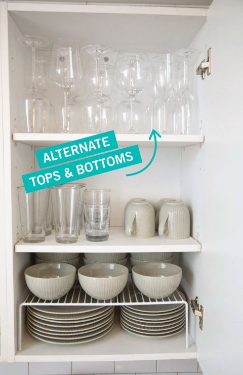 To make more space in yourcabinet, add a riser ($7, amazon.com) for plates and bowls, then alternate the direction you stand your wine glasses to fit more onto your shelf.