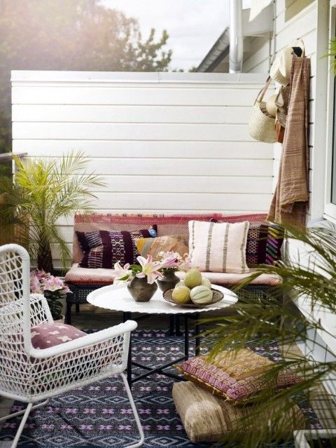 Get the Look: A Boho Patio.  Image found via: Expressen | 1. Palm from Home Flair | 2. Bench  from Crate and Barrel | 3. Chair from Ikea | 4. Pillow from Anitavee | 5. Pillow from West Elm | 6. Pillows from Amazon | 7. Pillow from Anitavee | 8. Potted Cala Lily from QVC | 9. Table from Post | 10. Tote from J. Crew