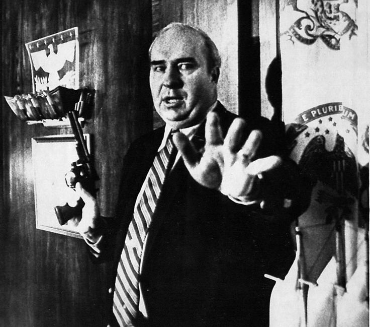 Robert Budd Dwyer, the 30th Treasurer of Pennsylvania, was accused of accepting bribes after allegedly receiving kickbacks from a California firm contracted to investigate the payroll tax inconsistencies. Throughout the whole scandal Dwyer denied the allegations yet was convicted in 1986.   On January 22, 1987, hours before he was to be sentenced for the bribery matter, Dwyer called a public press conference in which he pulled a .357 Magnum and shot himself in the head as cameras rolled.