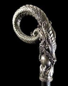 Dragon walking stick with pearl. Used as a staff of authority in Coven meetings.