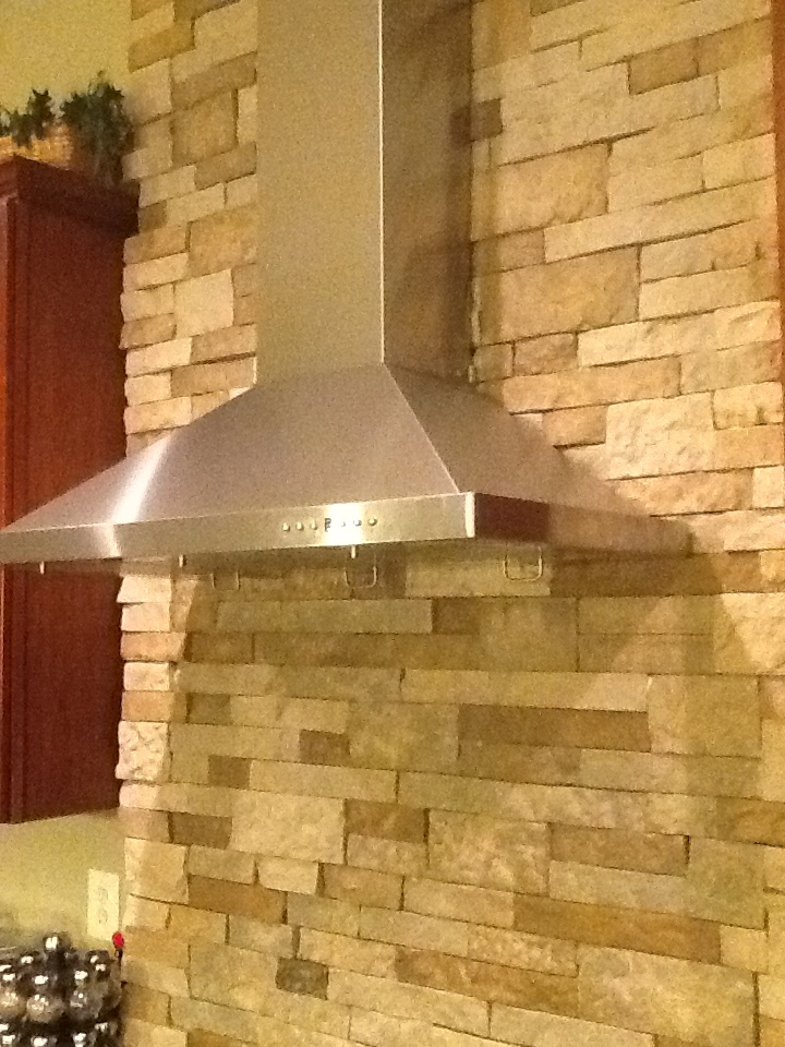 "36"" vent hood on stacked stone wall."