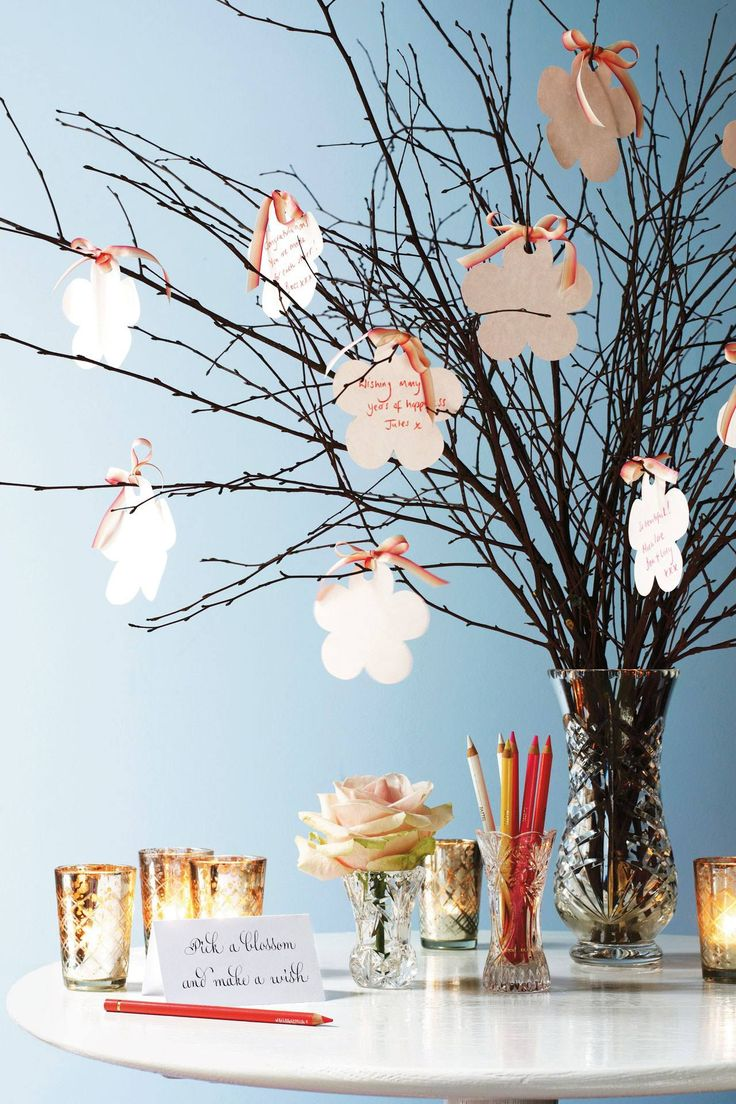A lovely idea to have branches as your guest book, with guests leaving their messages gradually creating their own decoration!