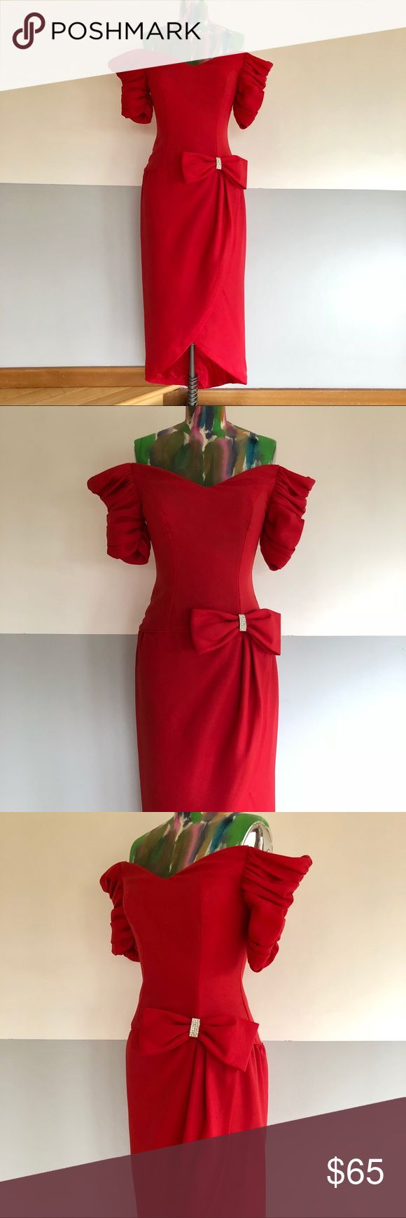 """VINTAGE 80s Red Crepe Cocktail Dress Stunning true red cocktail dress by Jordan.  Tulip skirt with rhinestone bow accent.  Gathered off-the-shoulder sleeves, perfectly on trend!  Elastic shoulder straps are sewn in (would recommend cutting them out!).  Near perfect condition, a few tiny pulls in fabric but overall AMAZING condition. Fully lined. Perfect for Valentine's Day!  Underarm Width: 30"""" Shoulder Width (top of sleeve): 44"""" Natural waist: 26"""" Front Length (top of dress to hem): 41""""…"""