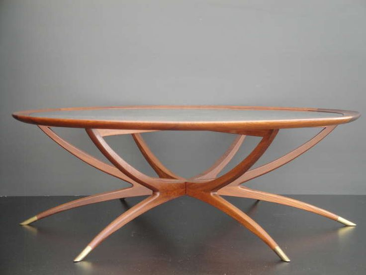 Mid Century Modern Spider Leg Teak Coffee Table | From a unique collection of antique and modern coffee and cocktail tables at http://www.1stdibs.com/furniture/tables/coffee-tables-cocktail-tables/