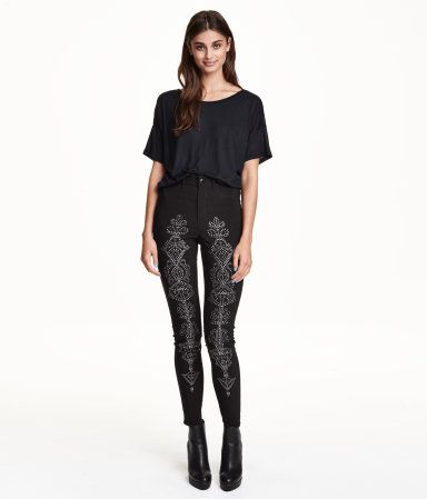 Pants in woven superstretch fabric with studs on legs. High waist, mock front pockets, and regular back pockets. Ultra-slim legs.