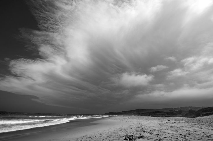Stormy clouds on the beach in Black and White