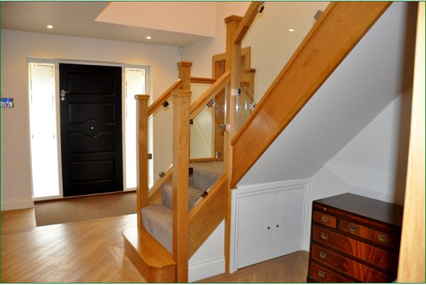 The Beeches Glass Staircase - American white oak staircase featuring a bull nose step leading to a quarter landing up to the first floor with a return balustrade.