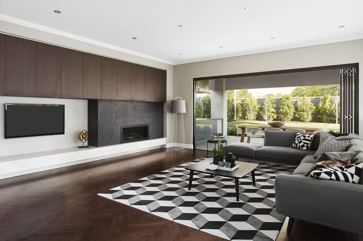 LIVING: Representing its style name, this living room evokes the very essence of architectural grandeur. Luminous smokey greys, rich walnut tones and white define this monochromatic colour spectrum. Visit High Street on our Lookbook here: http://www.metricon.com.au/get-inspired/lookbook/high-street
