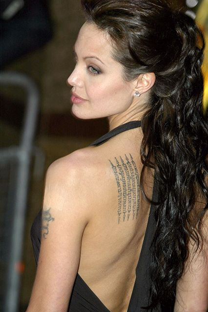Angelina Jolie  Yes, there was the Billy Bob fiasco, but Angelina Jolie was one of the first A-List women to ever have real, visible tattoos. The most graceful may be the Buddhist Pali incantation written in Khmer on her shoulder that she got to protect her son Maddox from bad luck.