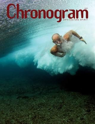 """Chronogram Magazine Cover, May 2007: """"The Human"""" by photographer, Alberto Guglielmi (color photograph   2006). This image is an underwater portrait of Italian surfer Nicolo Violati diving through a wave in the Maldives, an island chain off the coast of India. Photographer Alberto Guglielmi splits his time between his home & studio in the Ulster County hamlet of Accord, Sardinia, and Rome. Specializing in lifestyle and portraits, Guglielmi is also known for his extreme sports photography."""