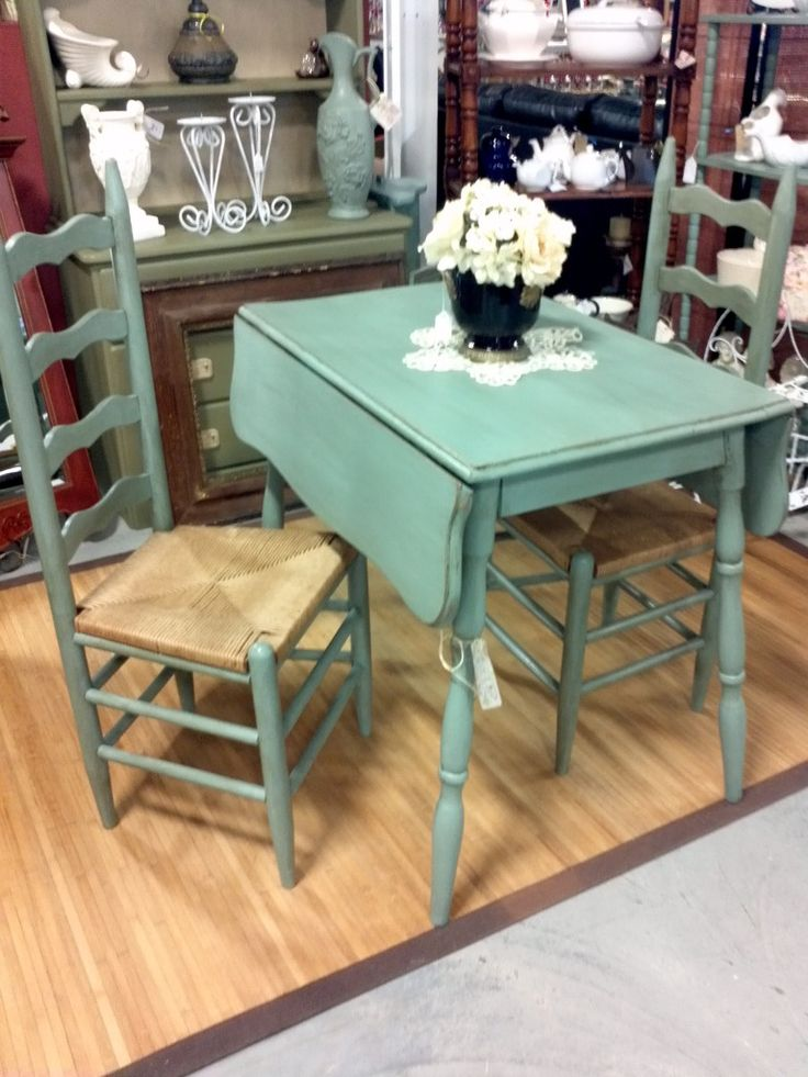 This set is like my drop leaf table & ladder back chairs.  I do like the single color redo.  Mine would look great in a combo of Emile, Old Violet & Paloma Annie Sloan Chalk Paints using a three color distress technique.  [Original Pin's Description:  Encore Resales Inventory :: $239 Table 2 Chairs image by EncoreResales - Photobucket]