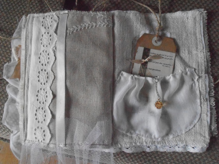 page with pocket inside lacy fabric album